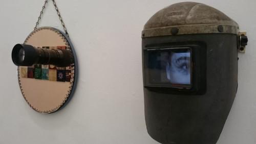 2019  'Psychosis'.  Vintage Welders Mask, IPad, Moving Image, Mirror, Video Recorder Lens, Print, Led Lights.