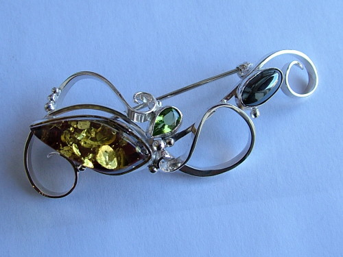 Green amber, peridot and hematite solid silver curl brooch
