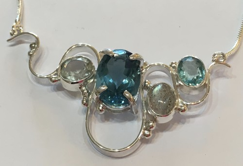Solid silver wave necklace with blue topaz, labradorite and green amethyst