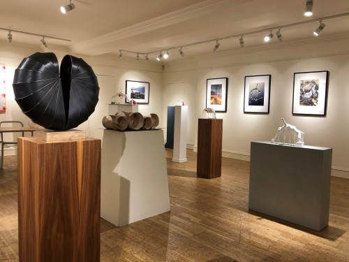 Collection of sculptures and photographic prints
