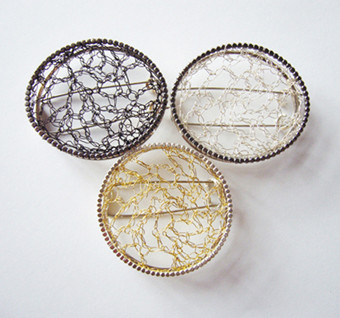 Frame Brooches, silver and plated wire